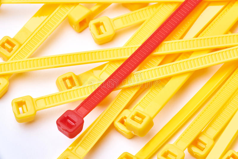 Yellow and red cable ties. Commercial photo on white background. royalty free stock photography