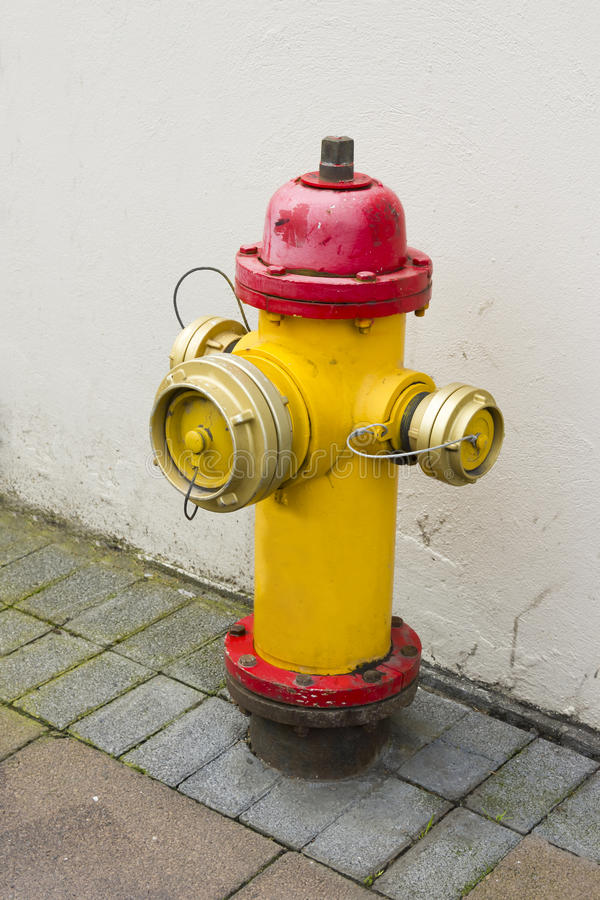 Yellow and red fire hydrant, Reykjavik. Yellow and red fire hydrant in Reykjavik royalty free stock image