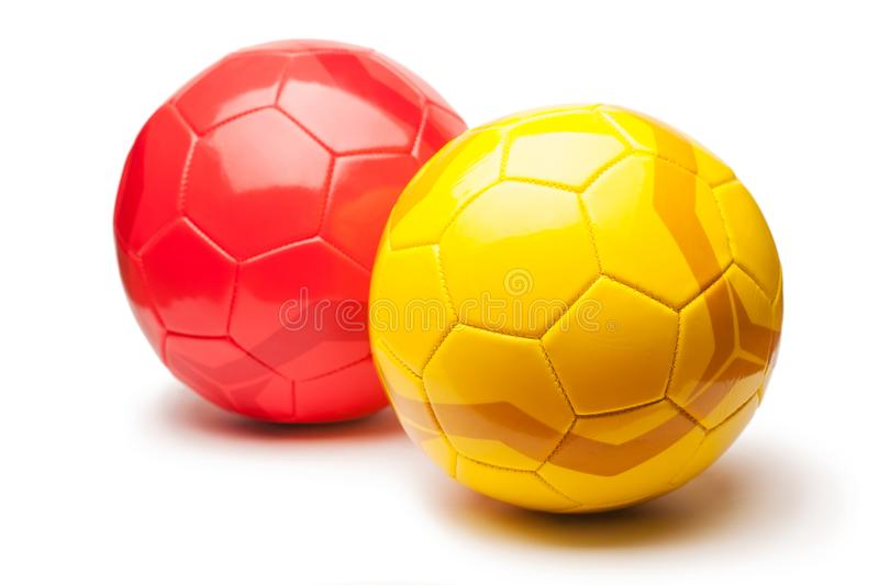 Yellow and red football balls, isolated on white. Background royalty free stock images