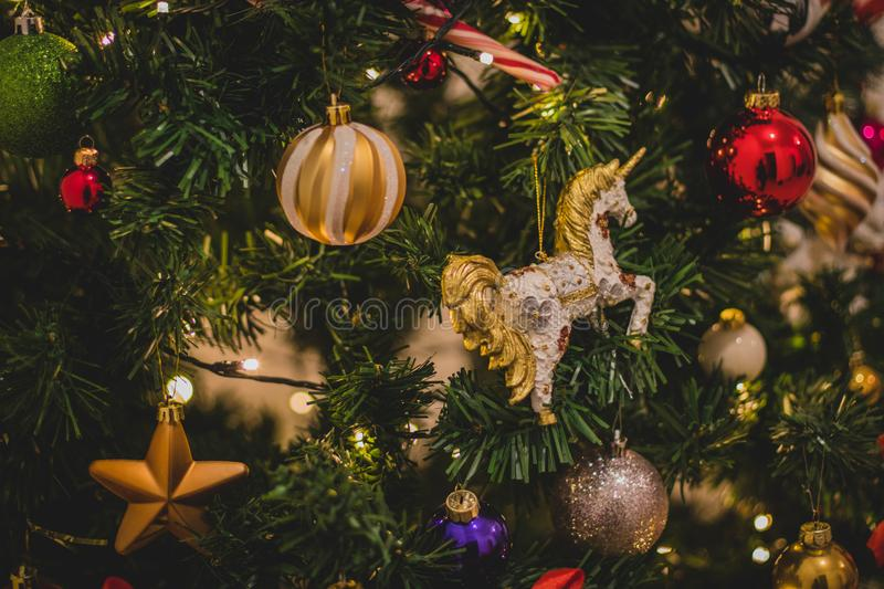 Yellow, Red, and Green Christmas Tree With Baubles stock photo