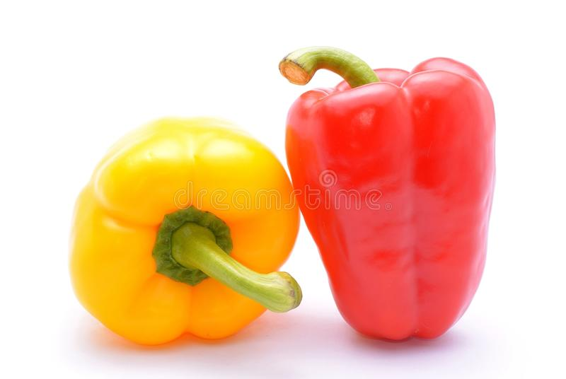 Yellow and red peppers (capsicum). Isolated on white background stock image