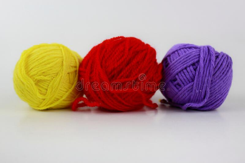 Yellow, red and purple yarn isolated on white background stock image
