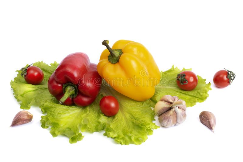 Yellow and red sweet pepper with tomatoes. Red sweet long pepper with yellow sweet pepper and tomatoes on a white background. Comp. Osition of yellow and red royalty free stock images