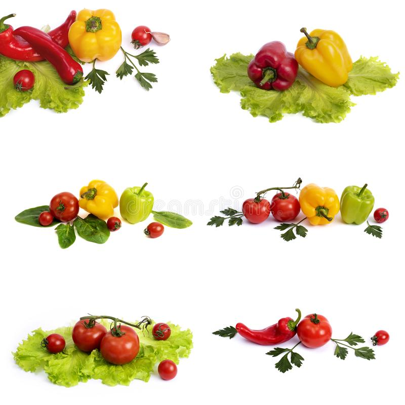 Yellow and red sweet pepper with tomatoes. Red sweet long pepper with yellow sweet pepper and tomatoes on a white background. Comp. Yellow and red sweet pepper royalty free stock photography