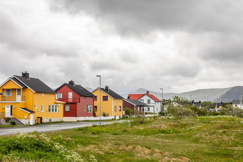 Yellow, red and white norwegian houses along the road in Andenes village, Andoy Municipality, Vesteralen district, Nordland county royalty free stock images