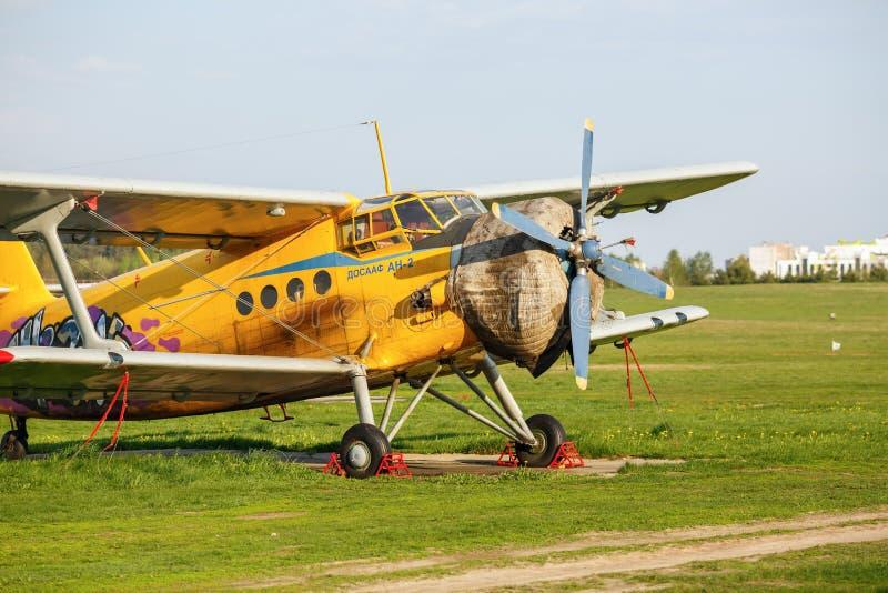 Yellow retro biplane royalty free stock photo