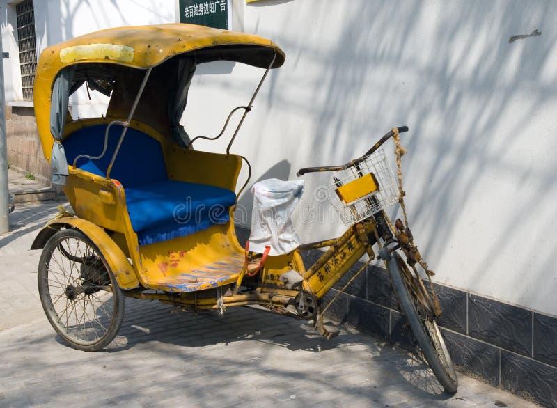 Yellow rickshaw stock image