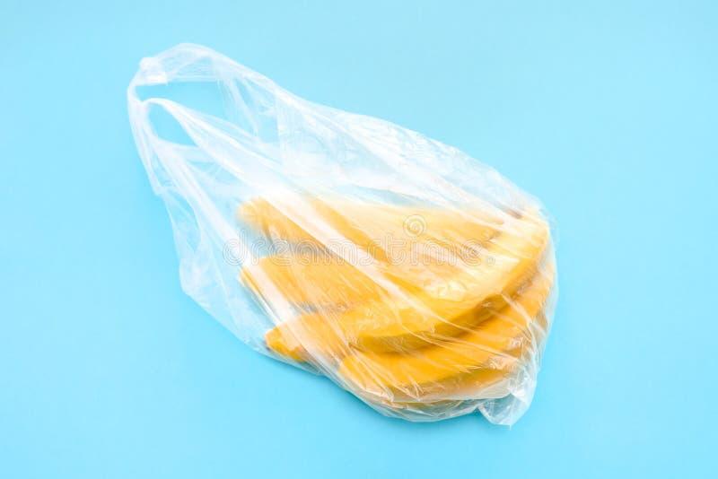 Yellow ripe fresh bananas in transparent plastic bag royalty free stock images