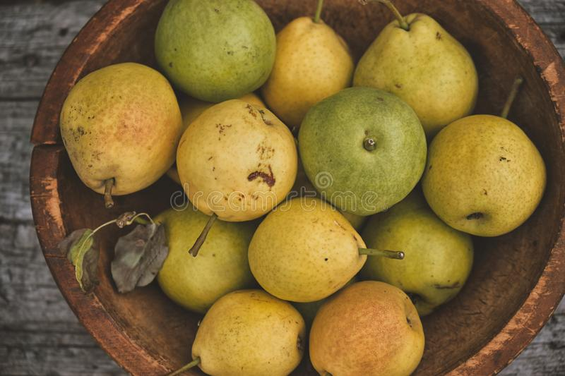 Yellow ripe pears in a bowl royalty free stock image
