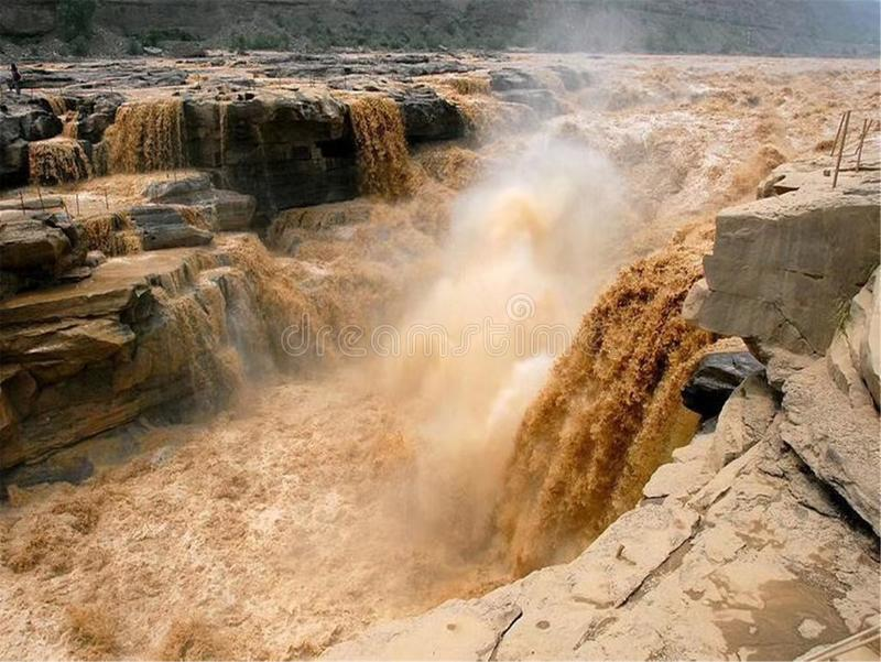 The Yellow River Hukou Waterfall Scenic Area, Hukou Waterfall, known as the `Yellow River Wonders`, is the only yellow waterfall o stock photo