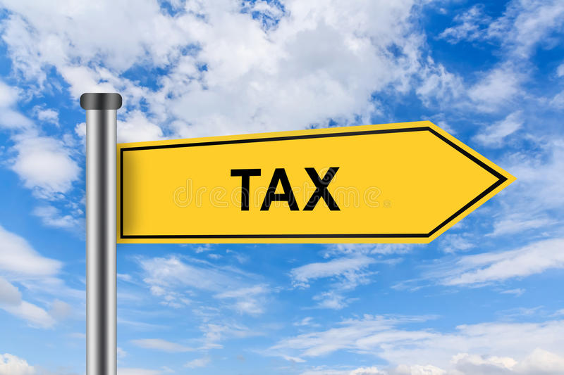 Yellow road sign with accounting tax words stock photo