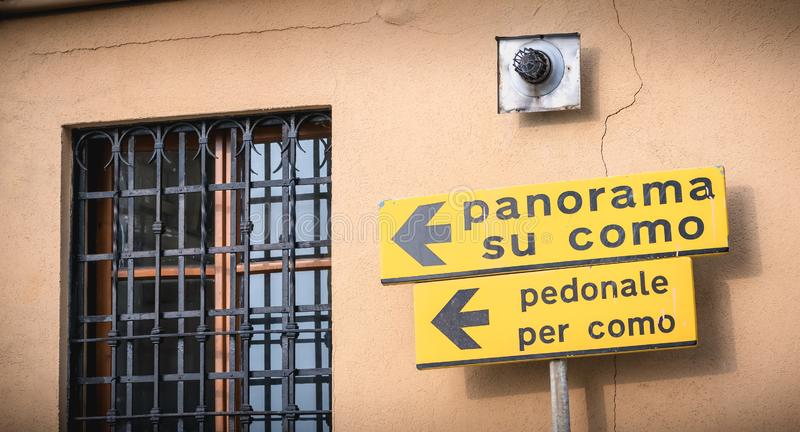 Yellow road sign indicating in Italian the direction of the Panorma of Como royalty free stock photo