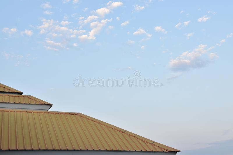 Yellow roof with sky royalty free stock photos