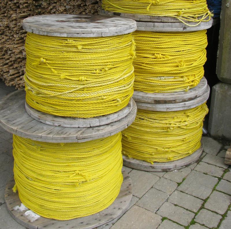 Yellow rope spools. Close up royalty free stock photo