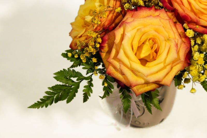 Yellow rose flowers arrangement isolated on white.  stock photo