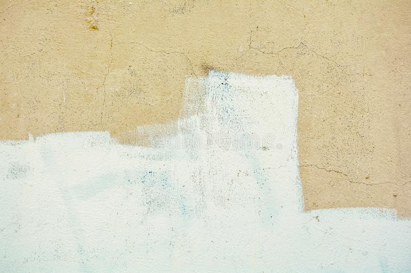 Yellow Rough Concrete Wall With Cracks And White Paint Stock Image ...