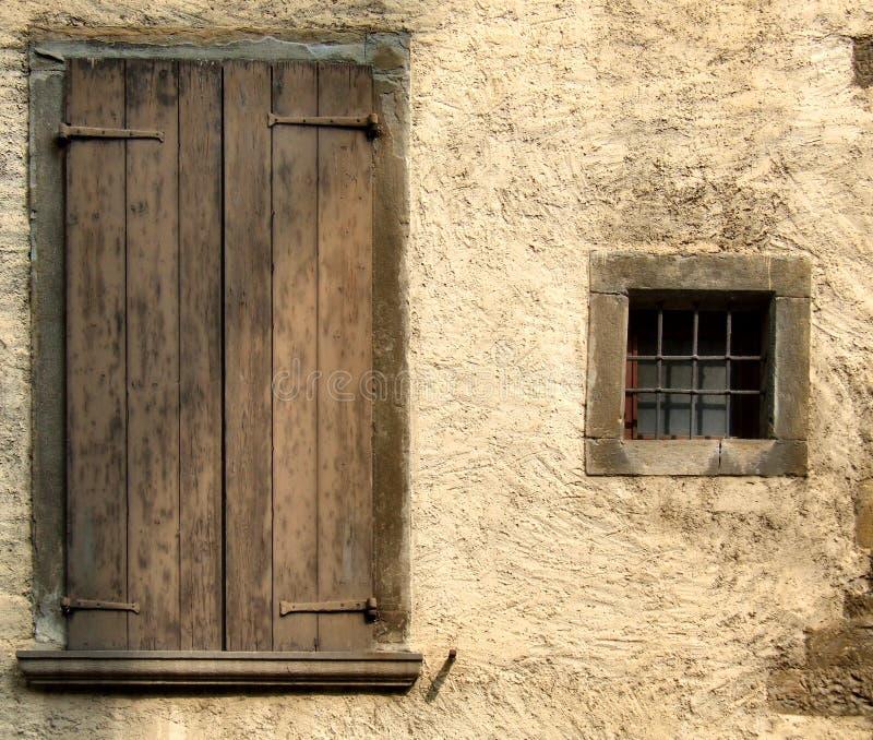 Yellow rough wall and windows stock photos