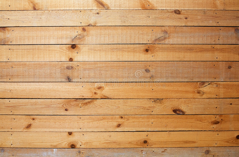 Yellow rough wooden wall. The surface of yellow rough wooden wall royalty free stock photo
