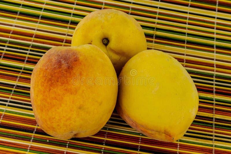 Yellow round peach three fruit whole fluffy mature close-up base of deserts beverage juicy sweet base royalty free stock image