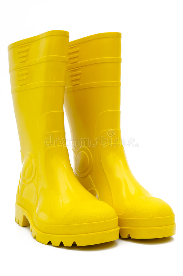 Yellow rubber boots isolated royalty free stock photos