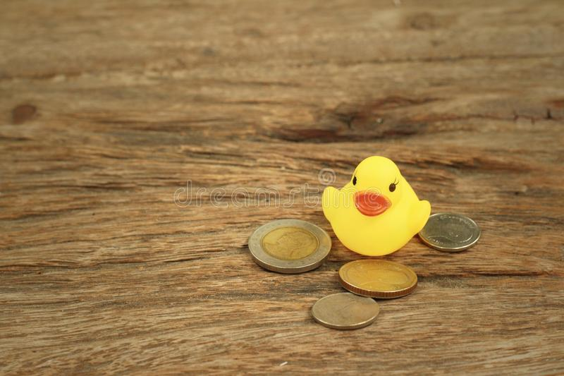 Yellow Rubber Duck With Money Of Thai Bath. Stock Image - Image of ...