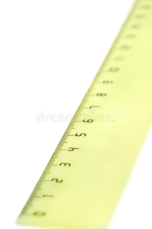Yellow ruler. Isolated on white background stock images