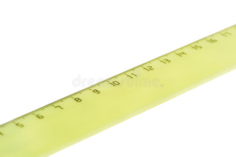 Yellow ruler. Isolated on white background stock photography
