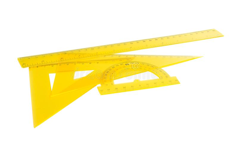 Yellow ruler isolated. On white background stock images