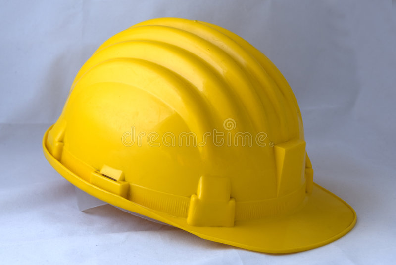 Yellow safety-gear. A yellow safety-gear used in construction sites stock photos