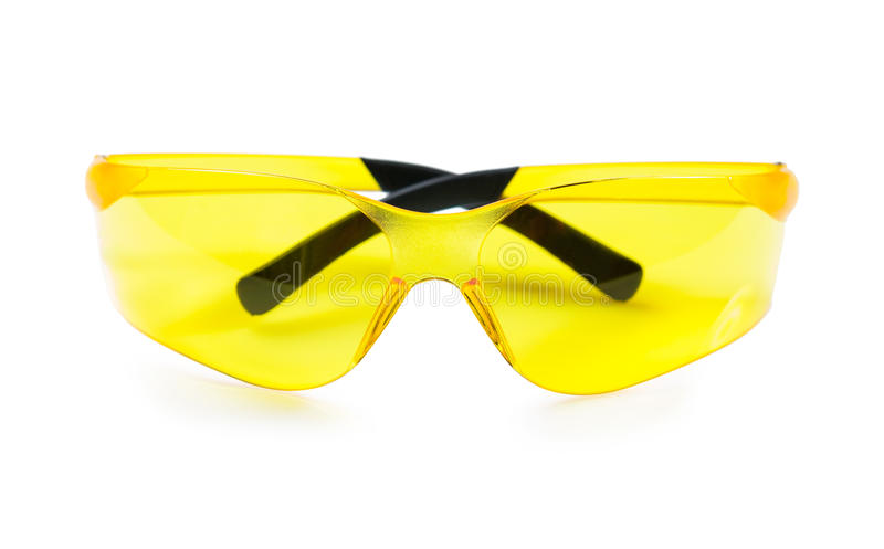 Yellow safety glasses isolated on white stock photography
