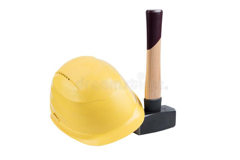 Yellow safety helmet on a small sledgehammer with wooden handle isolated on a white background, surface. Path saved, cut out. Cons royalty free stock photo
