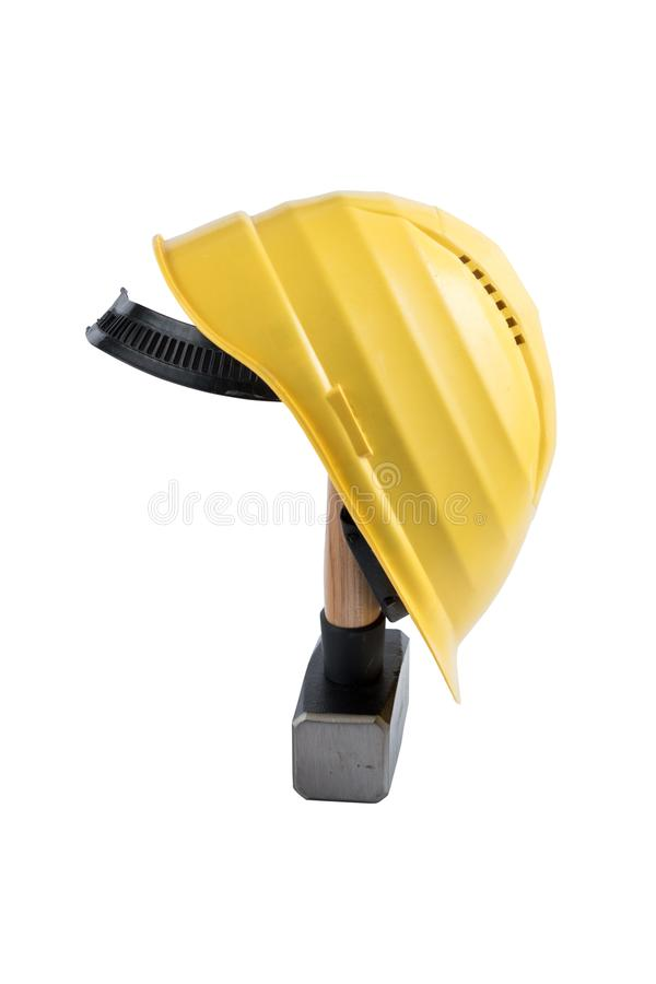 Yellow safety helmet on a small sledgehammer with wooden handle isolated on a white background, surface. Path saved, cut out. Cons stock image