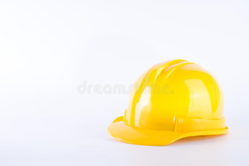 Yellow safety helmet on white background. Hard hat isolated on w. Hite. Safety equipment concept. Worker and Industrial theme royalty free stock images