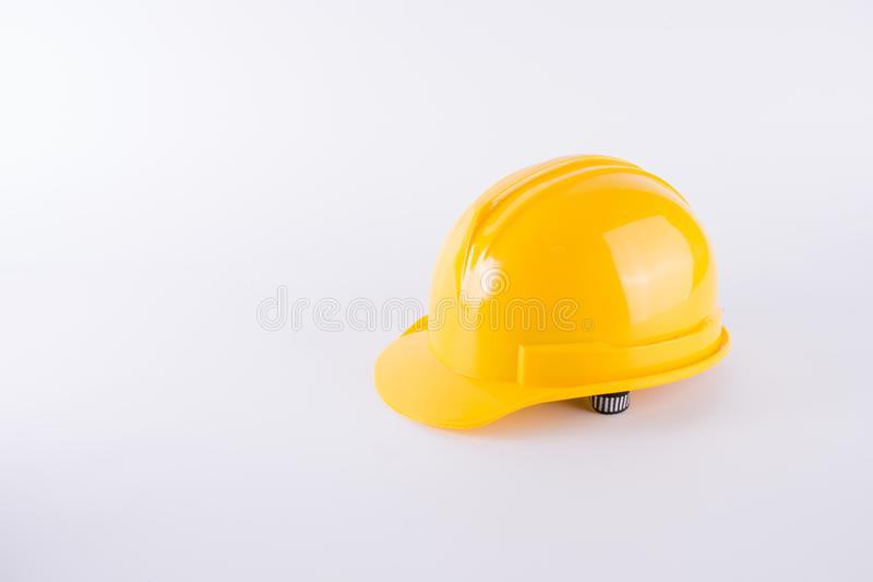 Yellow safety helmet on white background. Hard hat isolated on w. Hite. Safety equipment concept. Worker and Industrial theme royalty free stock photo