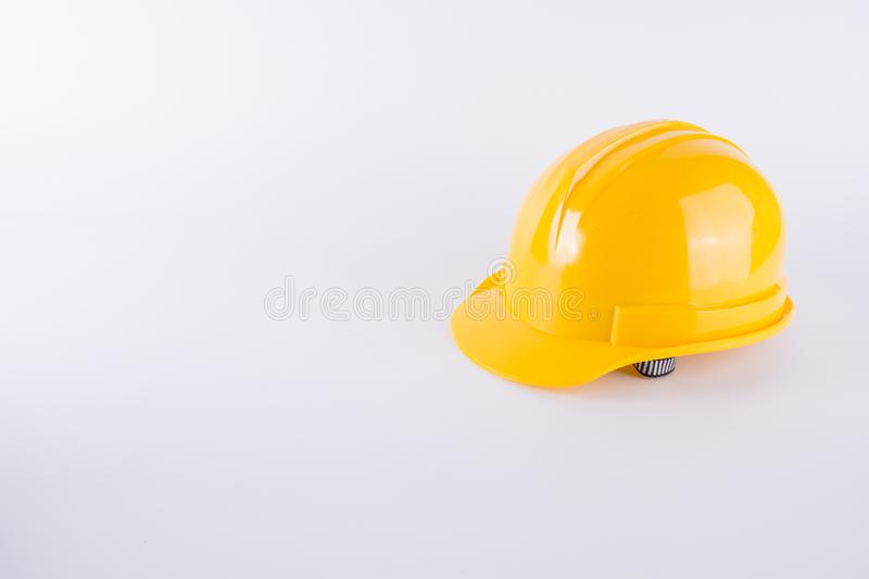 Yellow safety helmet on white background. Hard hat isolated on w. Hite. Safety equipment concept. Worker and Industrial theme stock photos