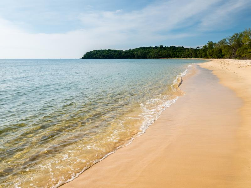 A yellow sand beach with clear water and blue sky royalty free stock photos