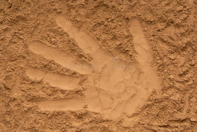 yellow sand, pattern of palm, trace of hand, hand impression, imprint of hand royalty free stock images