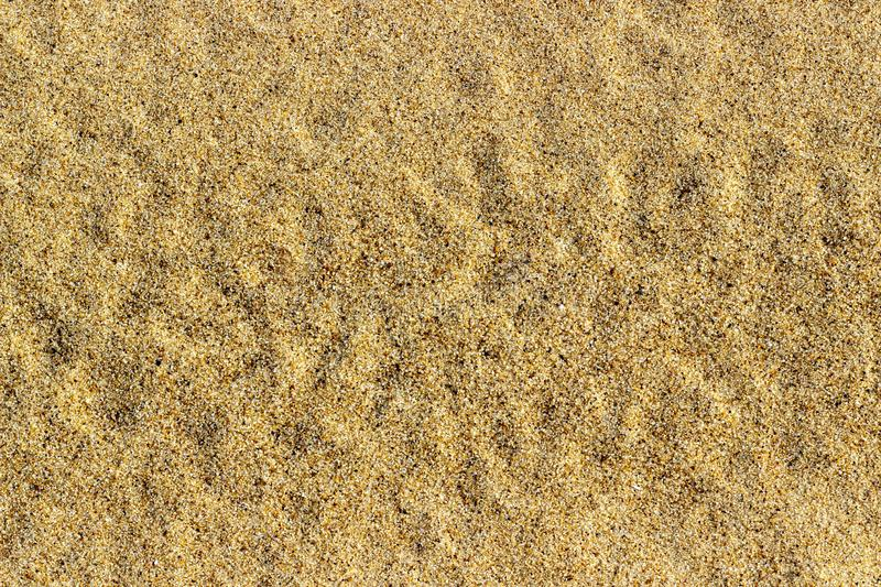 Yellow sand texture on the river. Abstract background stock image