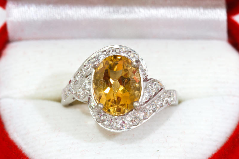 Yellow sapphire ring on white royalty free stock photography