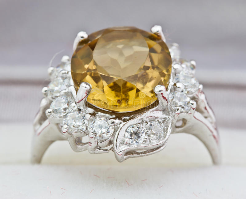 Yellow sapphire ring on white. Close-up Yellow sapphire ring on white stock photo