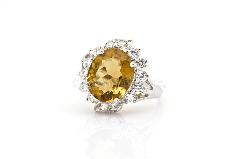 Yellow sapphire ring on white. Close-up Yellow sapphire ring on white stock image