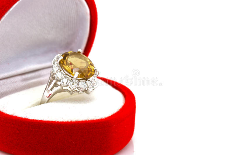 Yellow sapphire ring on white. Close-up Yellow sapphire ring on white stock photography