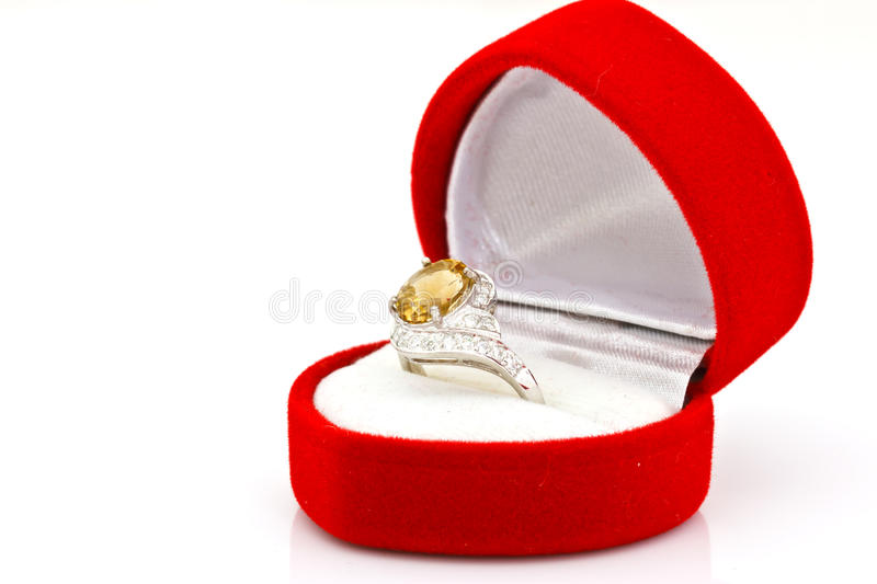 Yellow sapphire ring on white. Isolated stock images