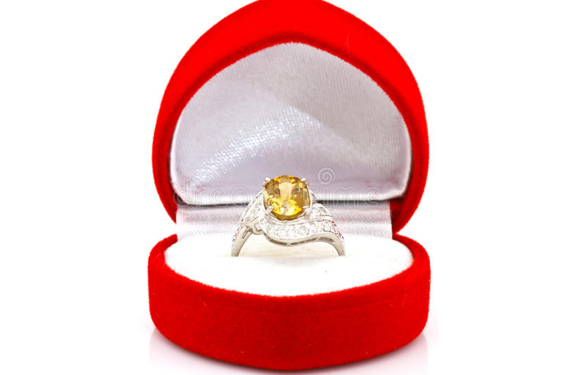 Yellow sapphire ring on white. Isolated stock photography