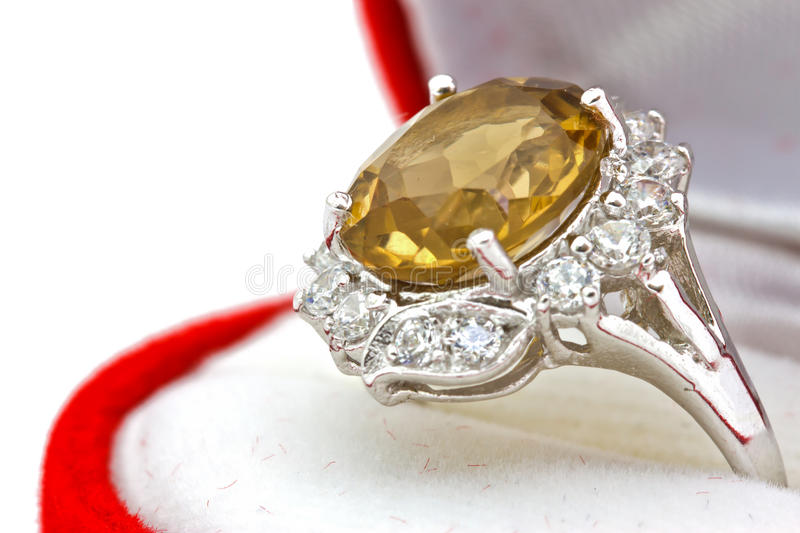 Yellow sapphire ring on white isolated background. Close-up Yellow sapphire ring on white isolated background stock photo