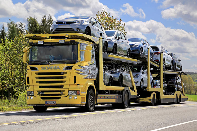 Yellow Scania R500 Car Carrier Hauls New Cars stock images