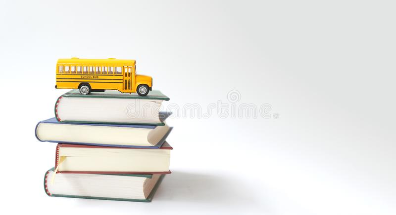 Yellow school bus with books, stock photos