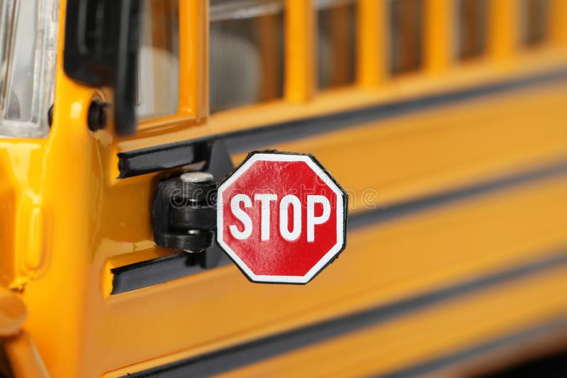 Yellow school bus, focus on stop sign. Transport for students royalty free stock photography