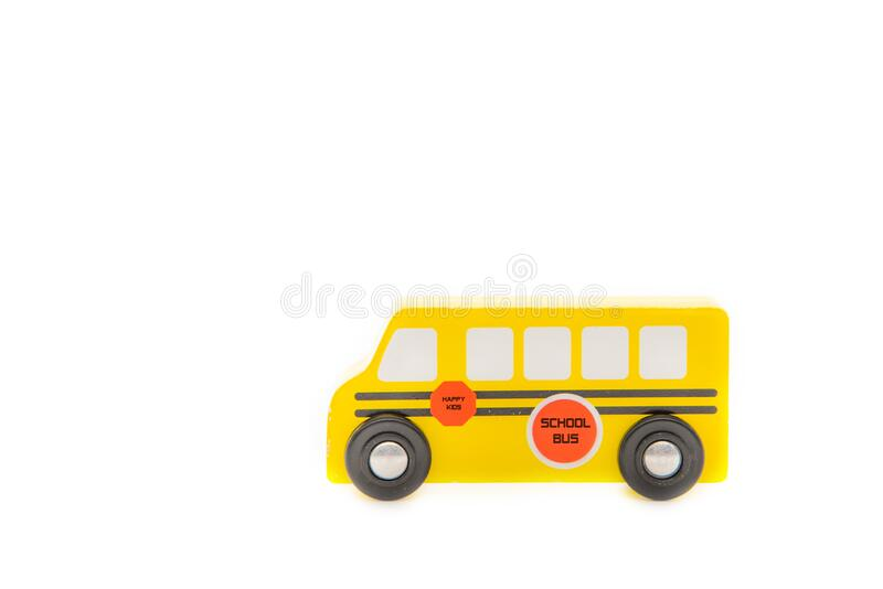 Yellow school bus toy. Isolated on white royalty free stock images