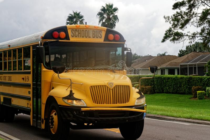 Yellow school bus in the USA royalty free stock image